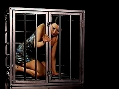 girl strips in a cage