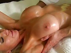 two blonde babes with big tits are kissing