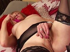mature lady playing with her sex toy