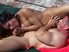 guy making love to a shemale by the swimming area