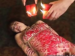 oriental prostitute gets candle wax all over her body